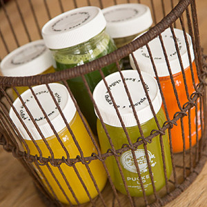 basket full of cold pressed raw juices