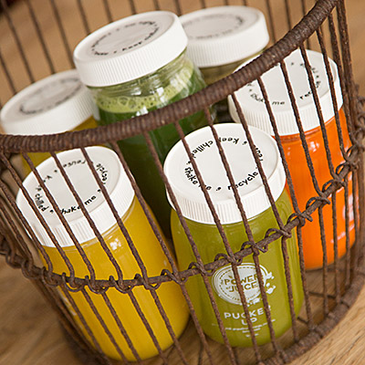 basket full of cold pressed raw juice